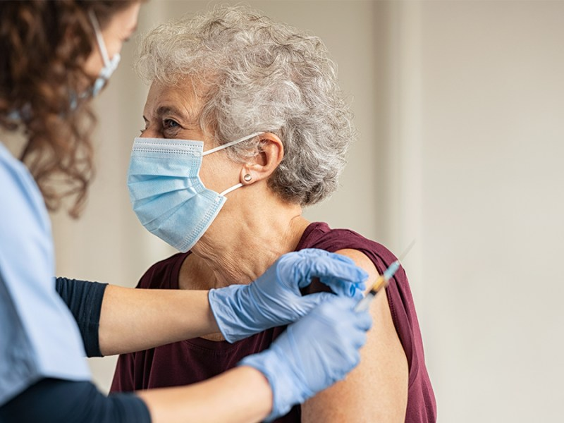 Woman taking the COVID-19 vaccine