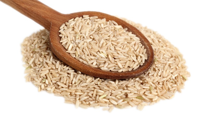 Brown rice against a white background