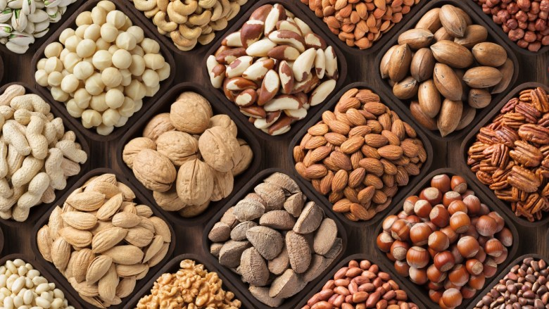 A selection of different types of nuts, including almonds and walnuts