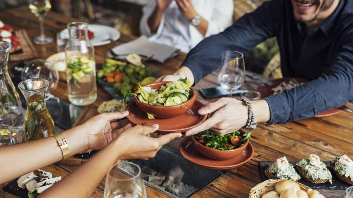 people handing plant-based food to each other