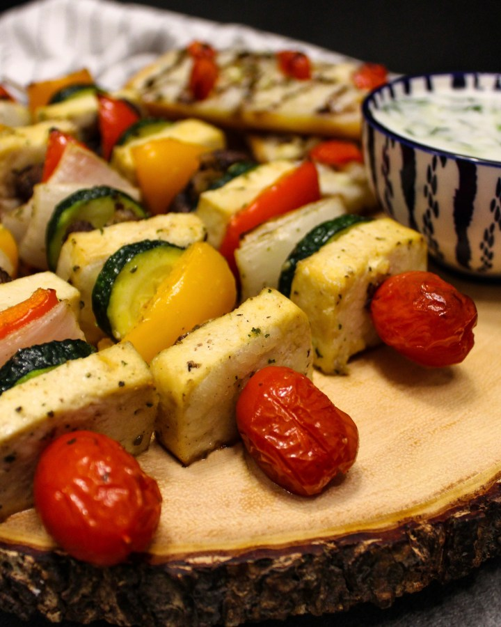 Marinated tofu souvlaki skewers with tomato, zucchini, peppers and onions