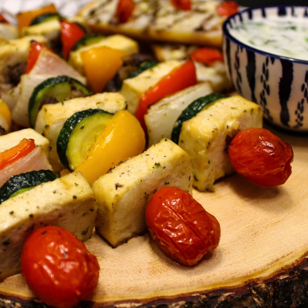 Marinated tofu souvlaki skewers with tomato, zucchini, peppers and onions
