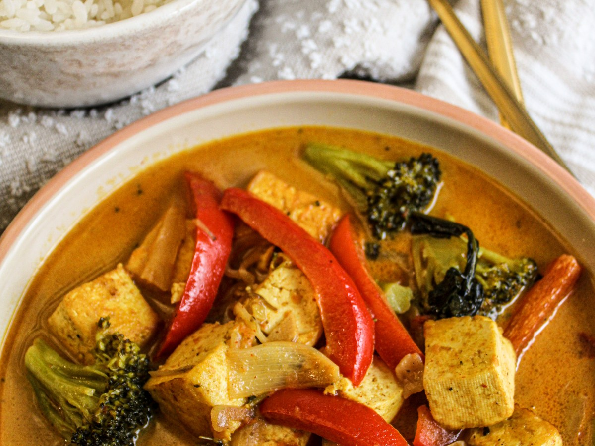 Coconut red curry in a bowl with rice