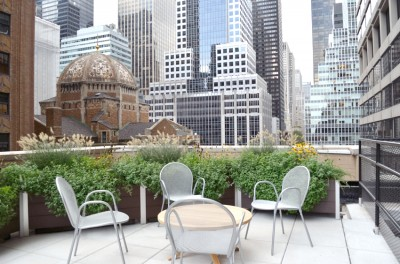 800 feet of DeepStream Designs lightweight planter, shown on a roof deck in midtown Manhattan, is made with maintenance free recycled plastic lumber