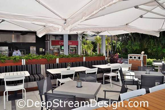 Click for more info on DeepStream movable commercial planter walls create a upscale outdoor tropical restaurant and DeepStream's custom restaurant fixtures