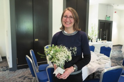 Cathryn Denby arranging flowers for the AGM