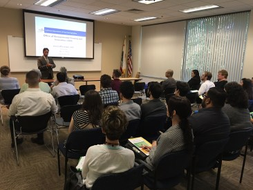 CDFA deputy secretary Kevin Masuhara speaks to an interested group of potential job seekers.