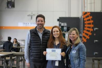 CDFA's Addison Ford (center) at the food drive wrap-up party with employees of the Sacramento Food Bank and Family Services