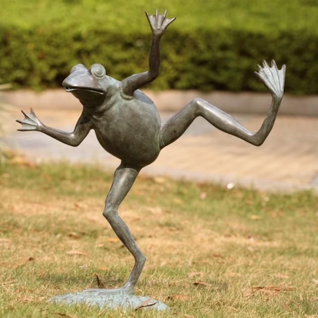 small sculpture dancing frog in garden