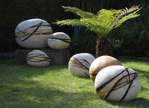 set of large stone balls on grass