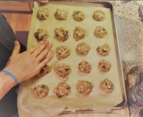 Before baking, lightly press the cookies down to flatten. This will ensure even browning