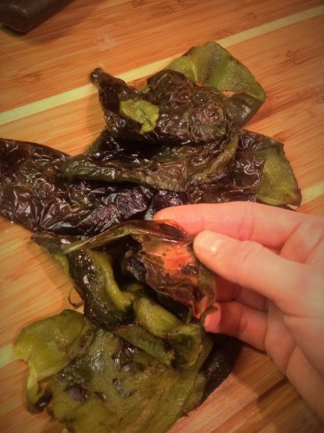 After the peppers are cool enough to handle, you can easily peel off the charred skins.