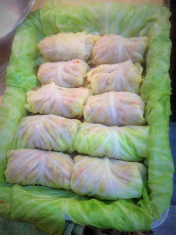 Chef's Tip: Use the darkest green (or outermost) leaves from the cabbage to line your casserole dish. Allow the leaves to drape over the edge. You'll use these later to cover the top of the cabbage rolls.