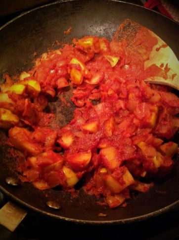 """Singe"" or ""caramelize"" the tomato paste for a couple of minutes to bring out the natural sweetness and darker color"