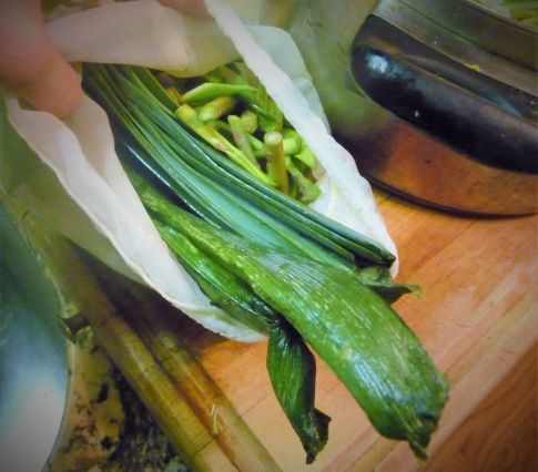 Save the green ends of the leeks and the woddy asparagus tips to flavor the broth for this recipe