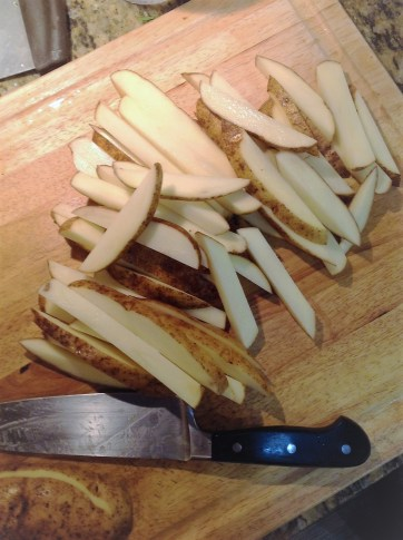 "Cut the potatoes into 1/2-inch thick ""batons"" for even roasting and crispy fries. The French call this ""batonnet"". Americans call it ""fry-cut""."