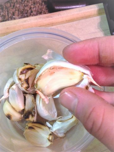 Charring the garlic with the peel on helps protect it so that it doesn't burn.
