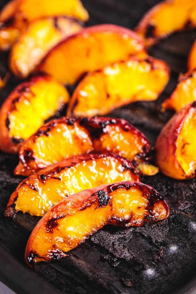 Grill Peaches to get a dark crust. This cooking technique is called caramelization. It's a healthy, oil-free way to bring out the natural sweetness