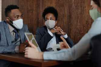 business people wearing face masks and talking