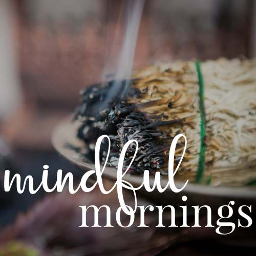 "Lit sage with smoke. Overlaid text reads: ""mindful mornings""."