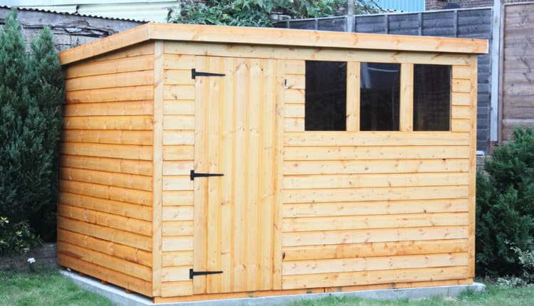 wooden shed with flat roof