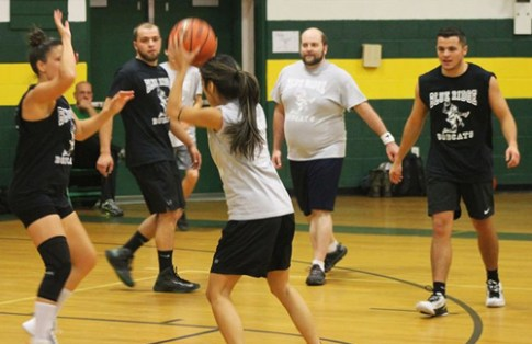 Venus Ramirez with the ball. Elyse King guarding her.