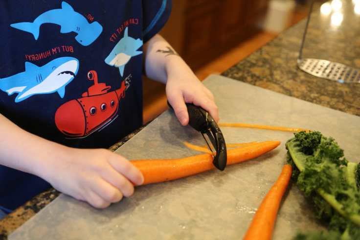 Child peeling carrots