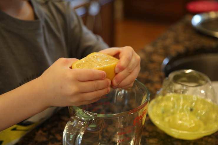 Child juicing lemon