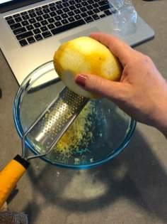 child Zesting lemon