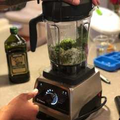 blending pesto ingredients in blender