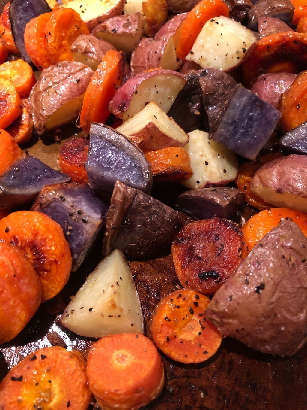 Garlic Roasted Potatoes and Carrots on a tray