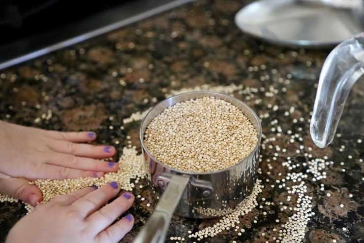 child measuring quinoa