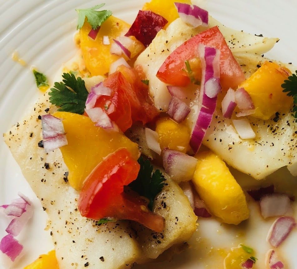 baked cod and peach salsa on plate