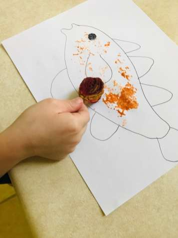 stamping peach core onto paper