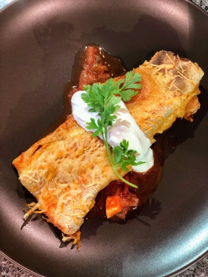 Chicken Enchiladas in pan, topped with sour cream