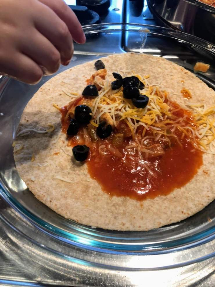 add olives to open enchilada