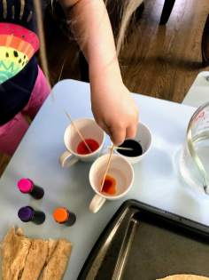 stirring colors in cup
