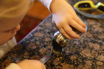 child measuring spice