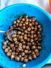 mixing chickpeas in bowl