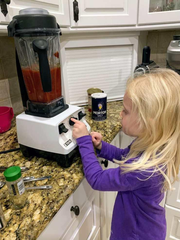 child operating vitamix