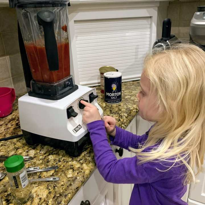 blonde child operating vitamix