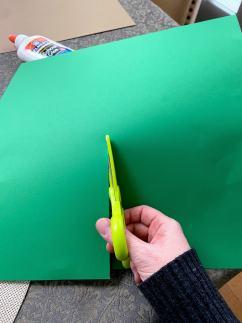 cutting green paper
