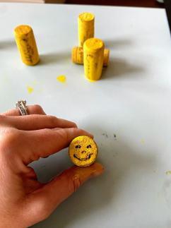 drawn face on wine cork
