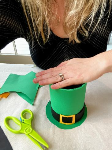 securing green hat to its base