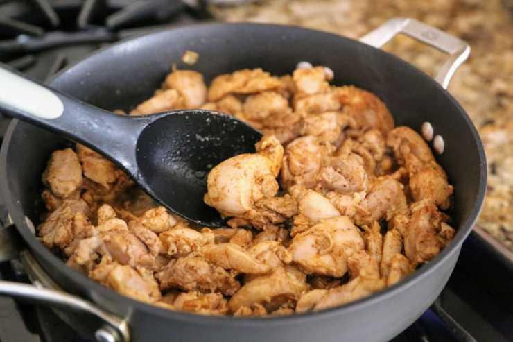 stirring chicken in oan