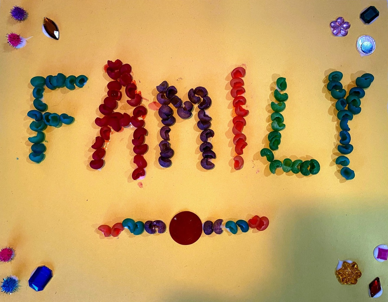 picture of word family made with colored shell pasta