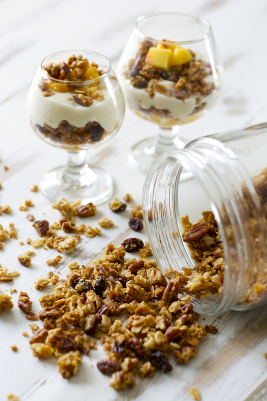 This Peach and Cinnamon Pecan Granola is the ultimate snack! It is packed with old fashioned oats, peach preserves, cinnamon, pecans and raisons!
