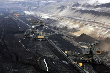 COTTBUS, GERMANY - MARCH 20:  Giant excavators extract lignite coal at the Jaenschwalde open-pit coal mine March 20, 2007 near Jaenschwalde, Germany. Though Germany has been among Europe's biggest proponents of CO2 emissions reductions, it remains heavily dependant on coal for its energy needs. The mine is run by the Swedish energy suppllier Vattenfall.  (Photo by Sean Gallup/Getty Images)