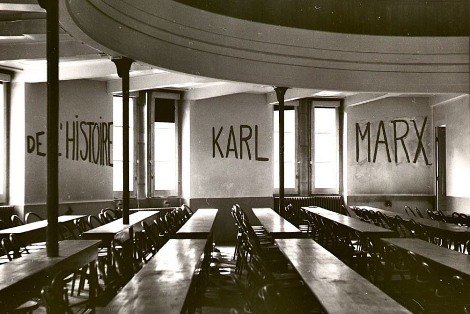 "Classroom at the University of Lyon with markings on wall reading ""DE L'HISTOIRE KARL MARX,"" made during student occupation of parts of the campus as part of the May 1968 events in France."