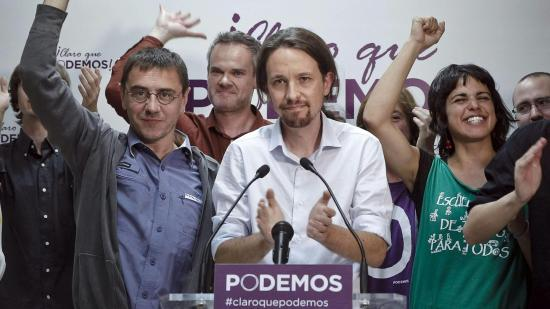Pablo Iglesias, the head of the electoral slate for the new Podemos party, with his Podemos party followers after electoral success in May 2014. Photo by: Emilio Naranjo (EFE)